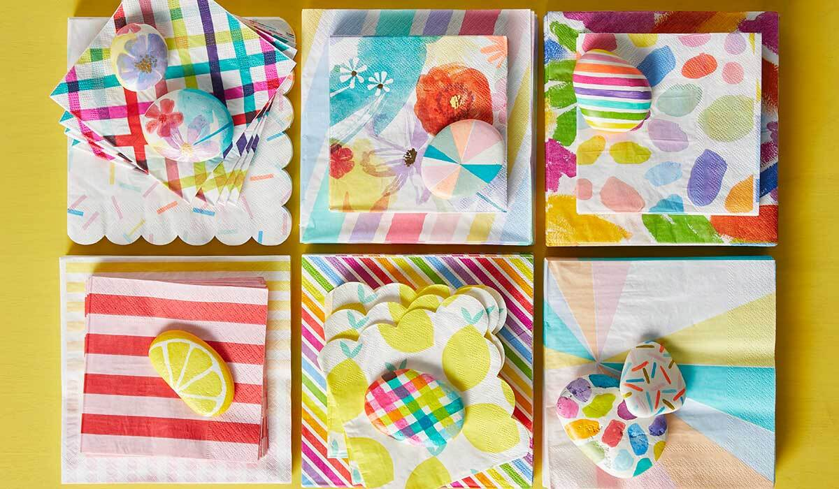 Brightly colored paper napkins and paper weights photo