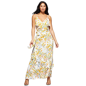 A woman wears a yellow floral print maxi wrap dress from Walmart photo