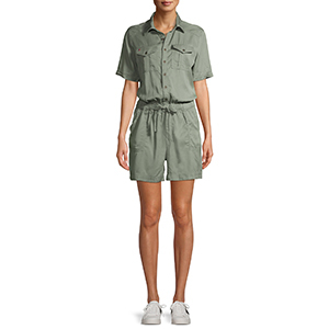 A woman wears a green utility romper from Walmart photo