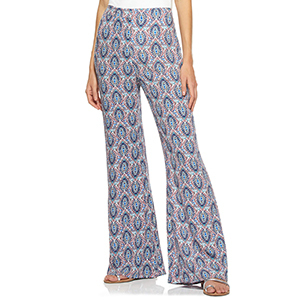 A woman wears patterned flare pants from Walmart photo