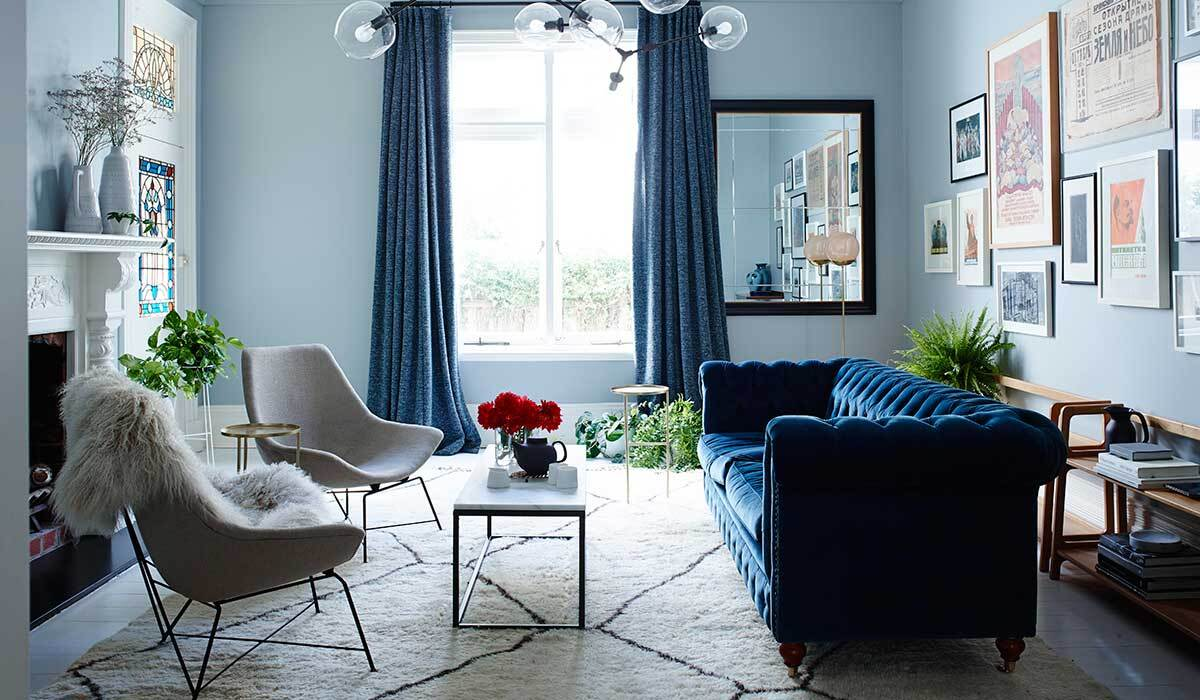 Living decorated with blue walls and furniture and cream accents