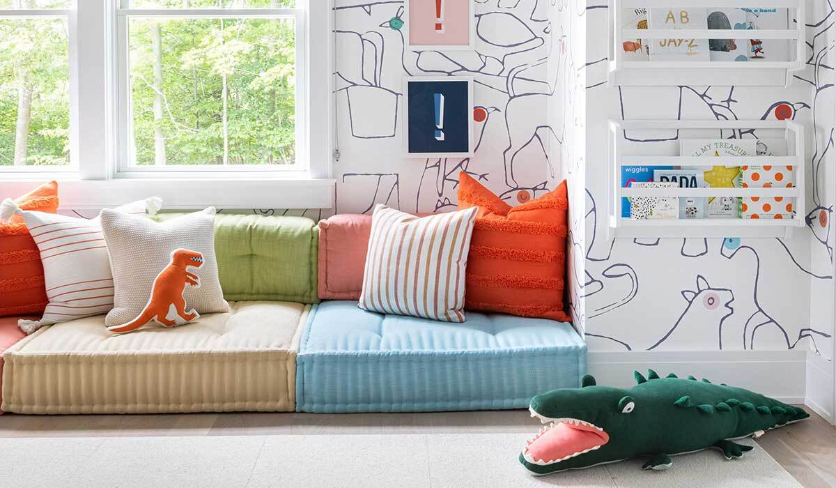 Kids' playroom with dinosaur and alligator pillows photo