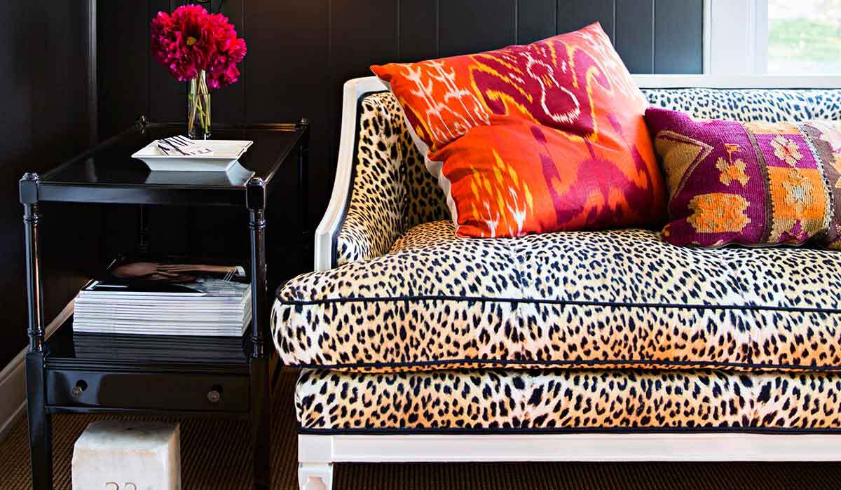Leopard-print sofa with colorful pillows photo