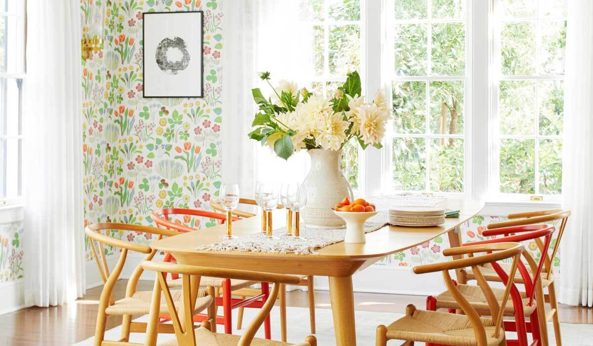A dining room decorated with floral decor photo