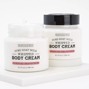Two white and black containers of Beekman 1802 Body Cream from QVC photo