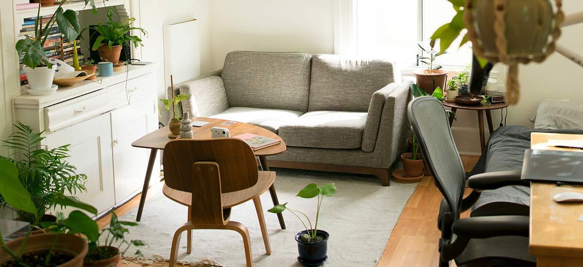 Small living room with a table and chairs, couch, and desk.