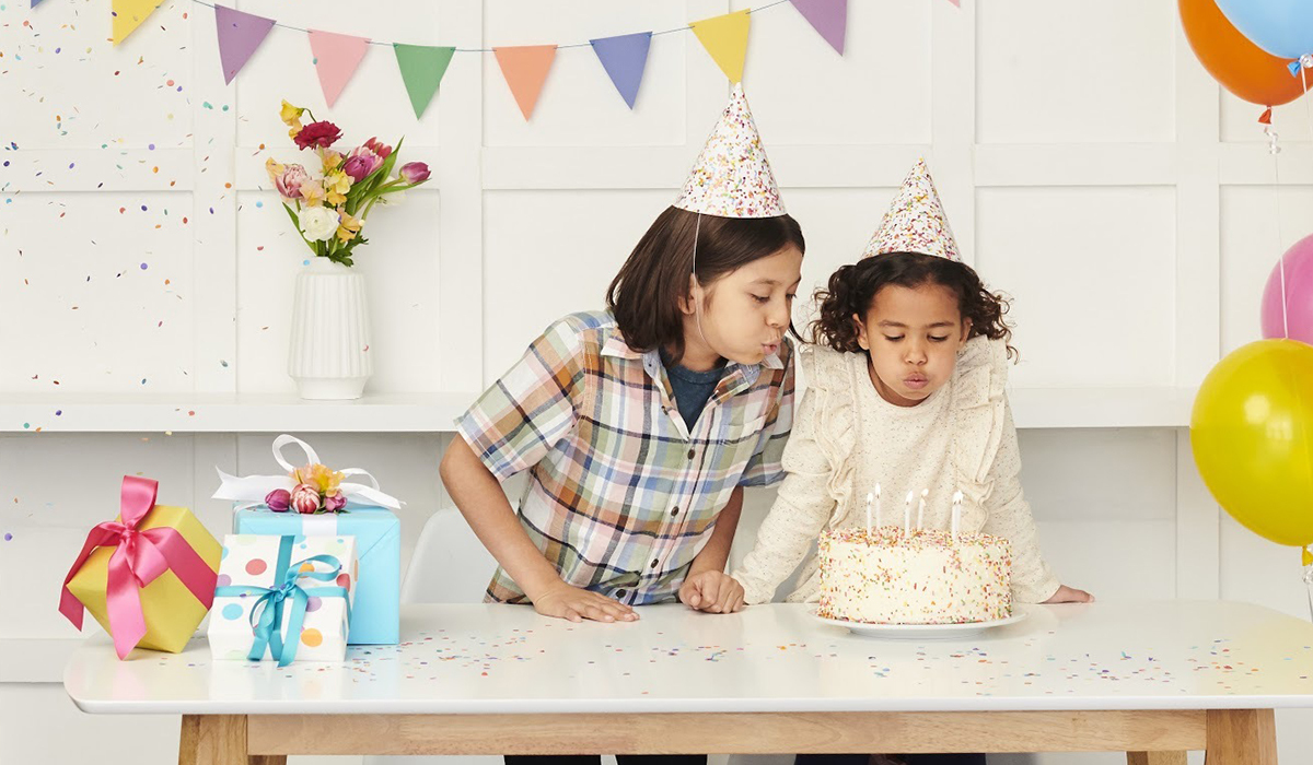 Two kids celebrating a birthday party