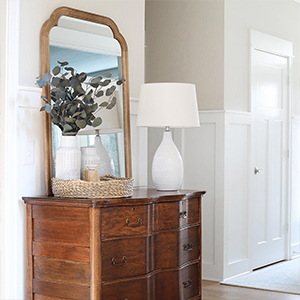 Wooden dresser with lamp from Walmart. photo