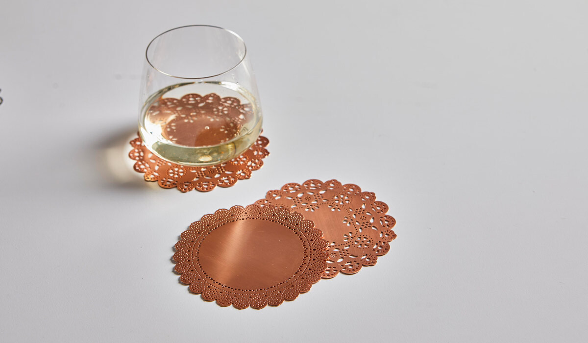 Copper coasters made of lace photo