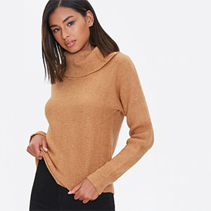 A woman wears a camel turtleneck sweater from Forever 21 photo