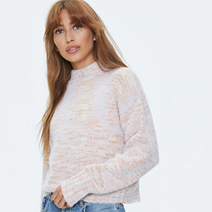 A woman wears a multicolored marled sweater from Forever 21 photo