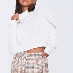 A woman wears a white cropped turtleneck sweater from Forever 21 photo
