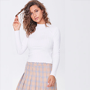 A woman wears a white lettuce edged sweater from Forever 21 photo