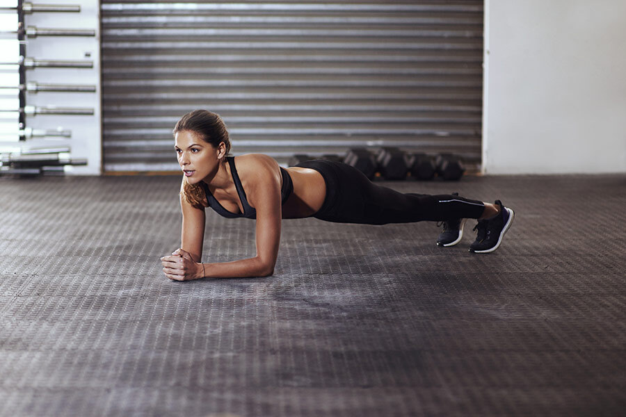 A woman exercises in a gym photo