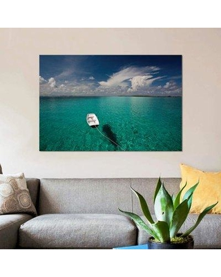 """East Urban Home 'Dinghy in Clear Turquoise Water Great Exuma Island Bahamas' Photographic Print on Canvas EBHS8297 Size: 18"""" H x 26"""" W x 0.75"""" D"""
