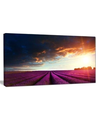 """Design Art 'Stunning Lavender Field Under Cloudy Sky' Photographic Print on Wrapped Canvas PT12381- Size: 28"""" H x 60"""" W"""