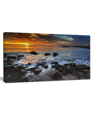 """Design Art 'Sunset Over Rocky Ocean Shore' Photographic Print on Wrapped Canvas PT14622- Size: 16"""" H x 32"""" W"""