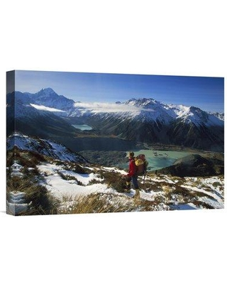 """East Urban Home New Zealand Mt Cook NP Hiker Viewing Aoraki 'Mueller Glacier Terminal Lake' Photographic Print on Wrapped Canvas NNAI3943 Size: 16"""" H x 24"""" W"""