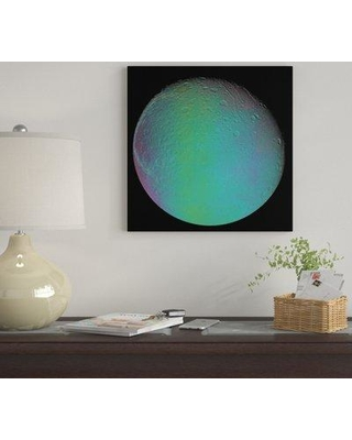 """East Urban Home 'False Color View Of Saturn's Moon Dione' By Stocktrek Images Graphic Art Print on Wrapped Canvas EUME7162 Size: 12"""" H x 12"""" W x 0.75"""" D"""