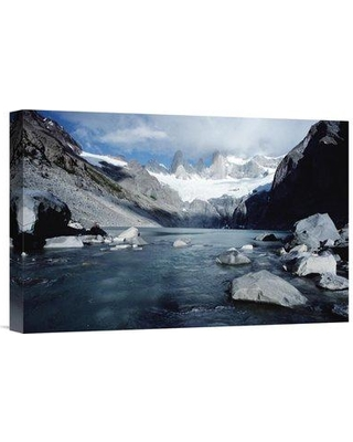 """East Urban Home 'Granite Spires Band Storm Clouds Fitzroy Massif Los Glaciares NP Argentina' Photographic Print EAUB4753 Size: 12"""" H x 18"""" W Format: Wrapped Canvas"""