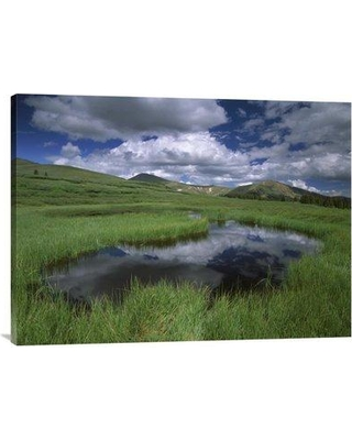 """East Urban Home 'Cumulus Clouds Reflected' Photographic Print on Canvas URBH8712 Size: 24"""" H x 32"""" W x 1.5"""" D"""