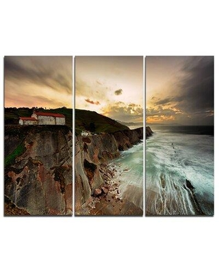Design Art Ocean Hitting Rocky Hill - 3 Piece Graphic Art on Wrapped Canvas Set PT9491-3P