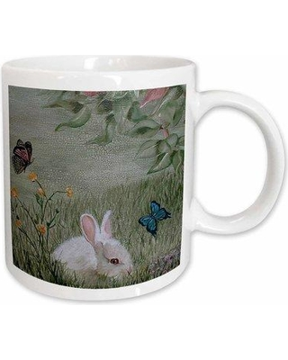 East Urban Home Bunny Rabbit in Grass with Butterflies Flying Nearby Coffee Mug W000112272