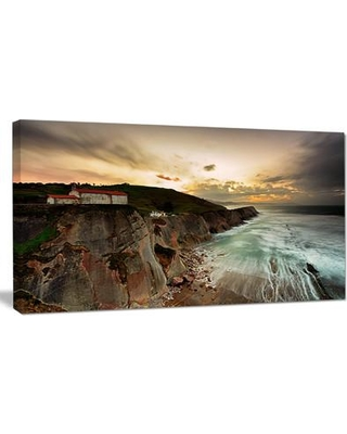 """Design Art 'Ocean Hitting Rocky Hill' Photographic Print on Wrapped Canvas PT9491- Size: 20"""" H x 40"""" W x 1"""" D"""