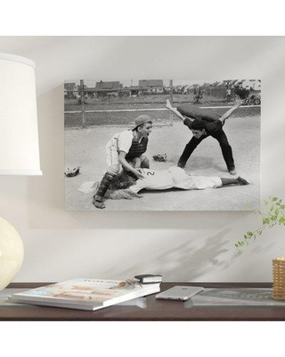 """East Urban Home '1950s Little League Umpire Calling Baseball Player Safe Sliding into Home Plate' Photographic Print on Wrapped Canvas ERNI4088 Format: Wrapped Canvas Size: 12"""" H x 18"""" W x 0.75"""" D"""