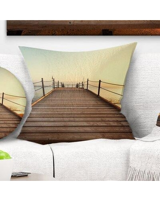 """East Urban Home Bridge Strong Wooden Boardwalk into Sea Pillow VOIN2390 Size: 18"""" x 18"""" Product Type: Throw Pillow"""