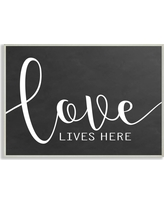"Stupell Industries 12.5 in. x 18.5 in. ""Love Lives Here"" by Lettered and Lined Printed Wood Wall Art, Multi-Colored"