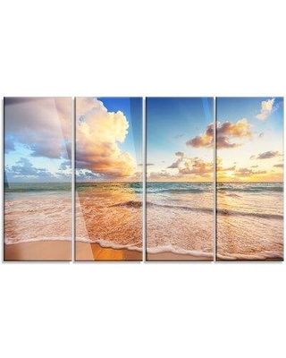 """Design Art 'Beautiful Cloudscape Over Beach' 4 Piece Photographic Print on Wrapped Canvas Set, Canvas & Fabric in Brown/Blue, Size Medium 25""""-32"""""""