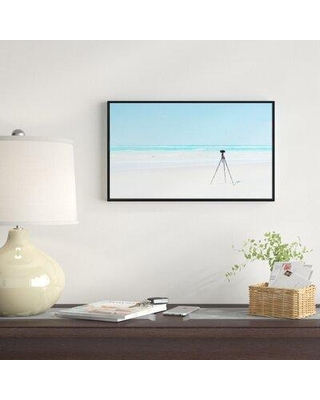 """East Urban Home 'Digital Camera and Tripod on Beach' Framed Photographic Print on Wrapped Canvas FSOI8787 Size: 18"""" H x 34"""" W x 1"""" D"""