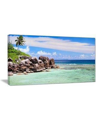 """East Urban Home 'Beautiful Seychelles Rocky Coast' Photograph ERNH7076 Size: 28"""" H x 60"""" W x 1.5"""" D Format: Wrapped Canvas"""