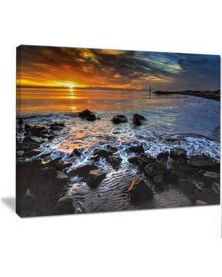 "Design Art 'Sunset Over Rocky Ocean Shore' Photographic Print on Wrapped Canvas PT14622- Size: 30"" H x 40"" W"