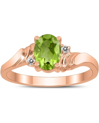 7X5MM Peridot and Diamond Wave Ring in 10K Rose Gold (8.5)