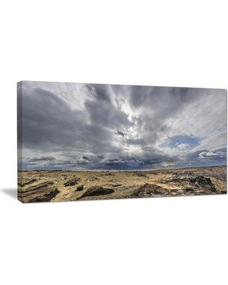 "Design Art 'Sky and Stones Under Dark Clouds' Photographic Print on Wrapped Canvas PT11688- Size: 28"" H x 60"" W x 1"" D"