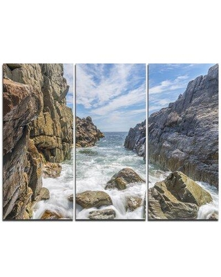 "Design Art Sea Waves Hitting Rocky Shore - 3 Piece Graphic Art on Wrapped Canvas Set, Canvas & Fabric in Brown/Blue, Size Medium 25""-32"" 
