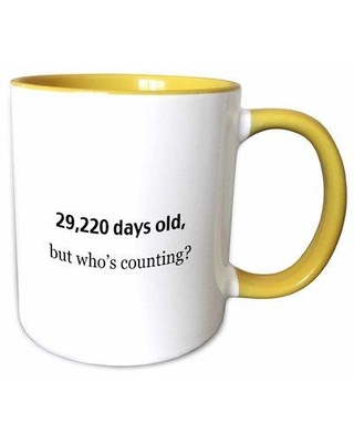 East Urban Home 29220 Days Old but Whos Counting Coffee Mug X112149014 Color: Yellow