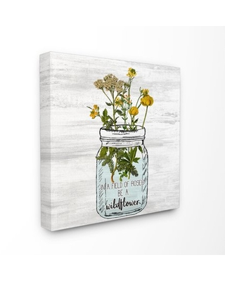 The Stupell Home Decor Be A Wildflower Yellow Flowers in a Mason Jar Canvas Wall Art