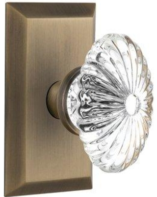 Nostalgic Warehouse Oval Fluted Crystal Glass Double Dummy Door Knob with Studio Plate NSTA2030 Finish: Antique Brass
