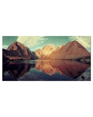"""East Urban Home 'Snow Mountain Lake' Photographic Print on Wrapped Canvas ETUC2127 Size: 16"""" H x 32"""" W x 1"""" D"""