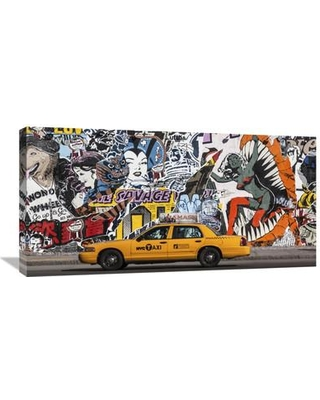 """Global Gallery 'Taxi and Mural Painting in Soho New York City' by Michel Setboun Photographic Print on Wrapped Canvas GCS-463471-1224-142 / GCS-463471-1836-142 Size: 18"""" H x 36"""" W x 1.5"""" D"""