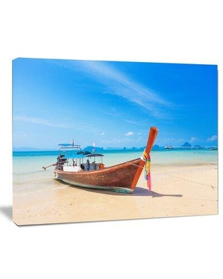 """Design Art 'Tropical Beach with Boat' Photographic Print on Wrapped Canvas PT9495- Size: 30"""" H x 40"""" W x 1"""" D"""