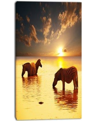 """Design Art 'Zebras in Water at Sunset' Photographic Print on Wrapped Canvas, Canvas & Fabric in Yellow, Size 32"""" H x 16"""" W x 1"""" D 