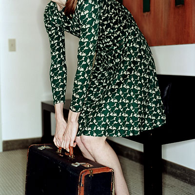 woman-lifting-suitcase