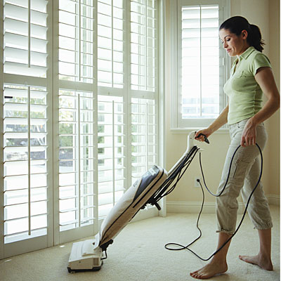 woman-vacuuming-house