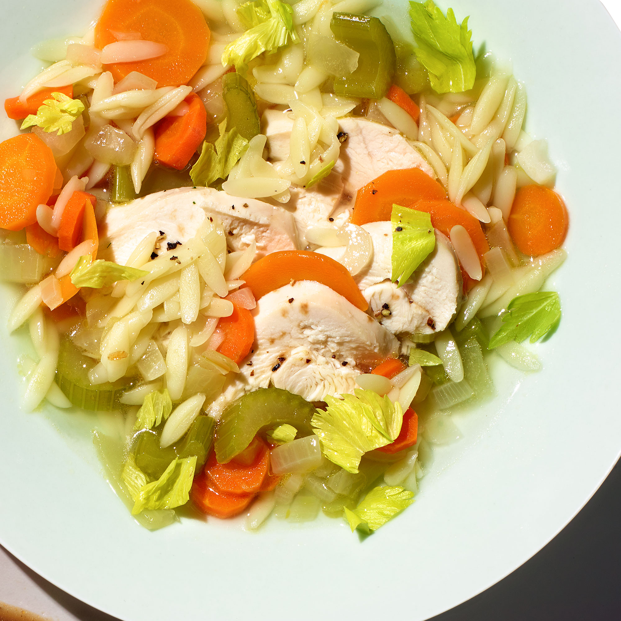 Chicken and Toasted Orzo Soup with Celery Greens