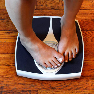 8. Work with a nutritionist to help you lose a moderate amount of weight, if necessary.