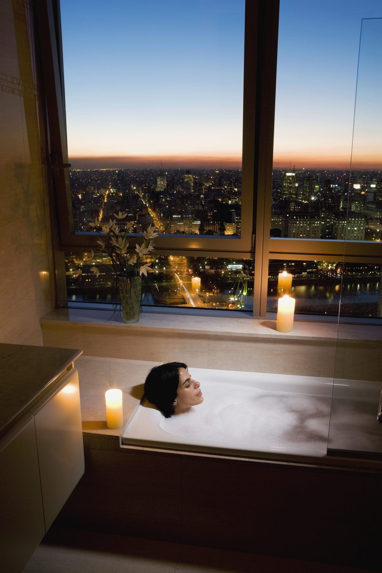 Woman taking a relaxing warm bath before bedtime